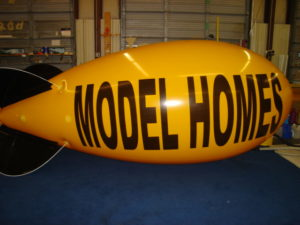 Best selling advertising blimps in Rochester, NY. USA manufacturer of helium advertising balloons.